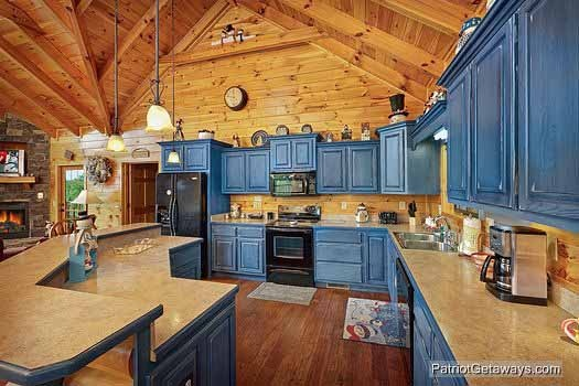 kitchen with blue cabinets at winter wonderland a 3 bedroom cabin rental located in pigeon forge