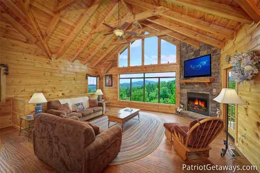 living room with fireplace at winter wonderland a 3 bedroom cabin rental located in pigeon forge