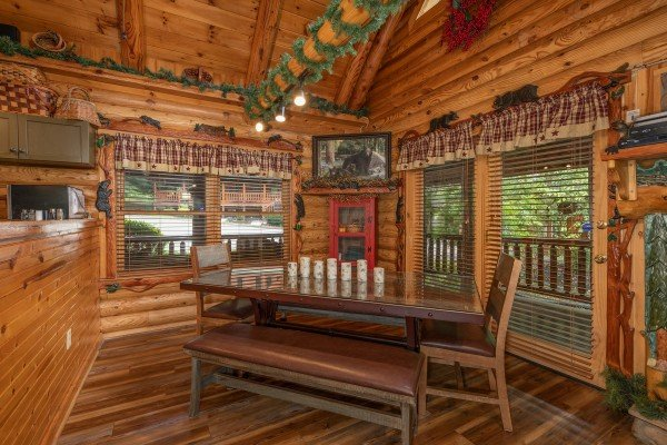 Dining table with benches at Creekside Lodge, a 6-bedroom cabin rental located in Pigeon Forge