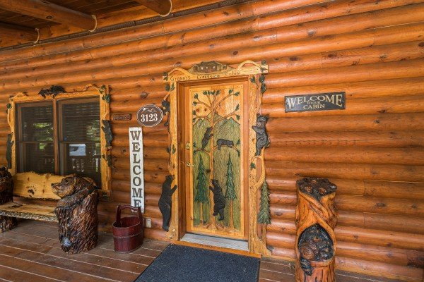 Front entry door at Creekside Lodge, a 6-bedroom cabin rental located in Pigeon Forge