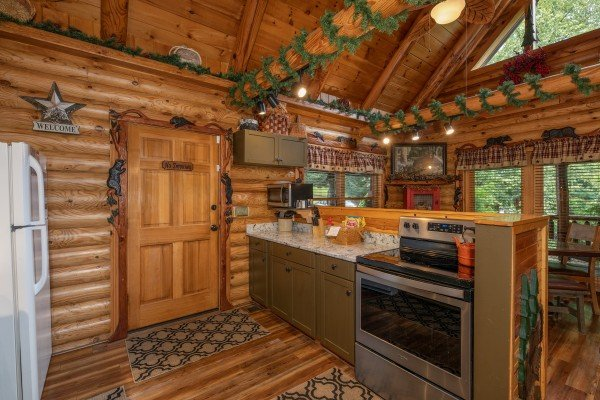 Stainless stove and cabinets in the kitchen at Creekside Lodge, a 6-bedroom cabin rental located in Pigeon Forge