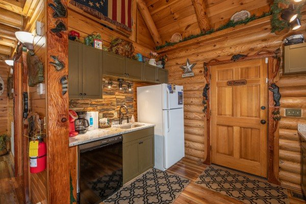 Dishwasher, sink, and fridge at Creekside Lodge, a 6-bedroom cabin rental located in Pigeon Forge