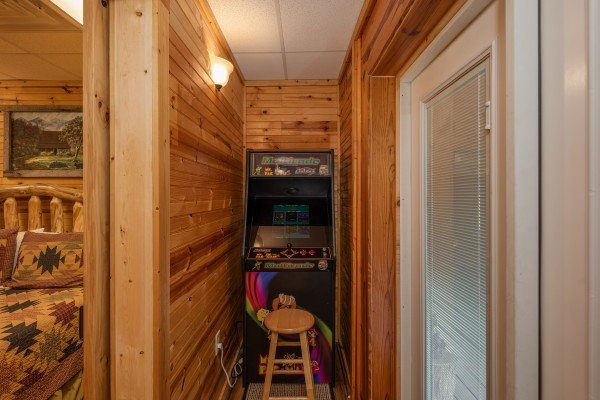 Multigame arcade at Creekside Lodge, a 6-bedroom cabin rental located in Pigeon Forge
