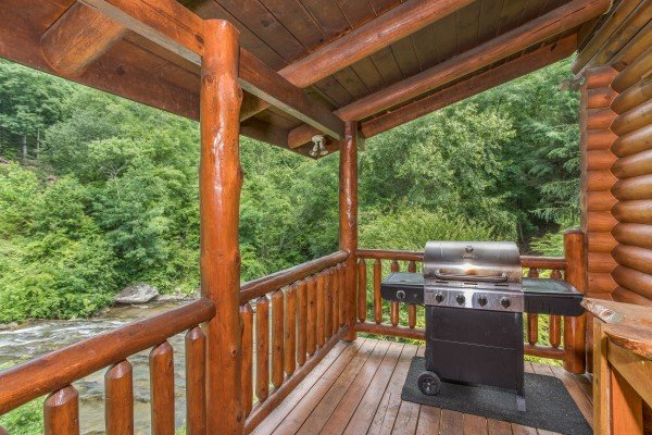 Propane grill on the deck at Creekside Lodge, a 6-bedroom cabin rental located in Pigeon Forge