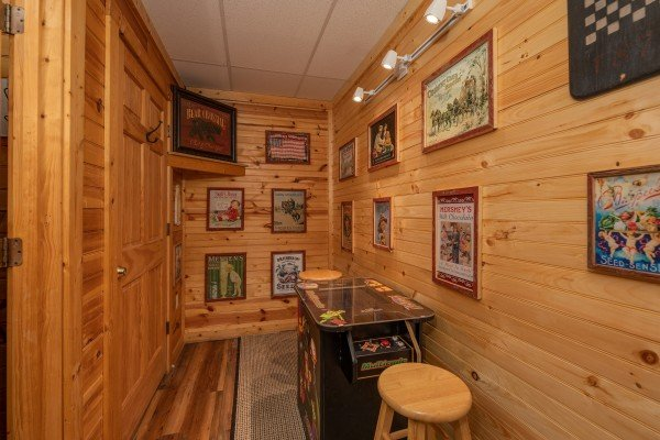 Table arcade game at Creekside Lodge, a 6-bedroom cabin rental located in Pigeon Forge