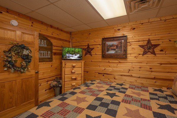 Dresser and TV in a bedroom at Creekside Lodge, a 6-bedroom cabin rental located in Pigeon Forge