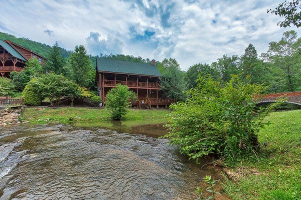 Looking across the creek at Granny's Creekside Cabin, a 6-bedroom cabin rental located in Pigeon Forge