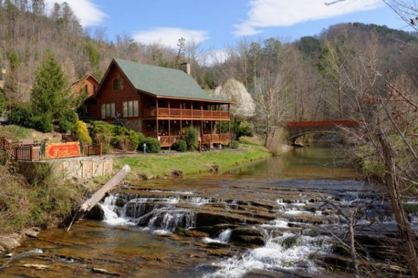 Water feature and cabin sitting creekside at Granny's Creekside Cabin, a 6-bedroom cabin rental located in Pigeon Forge