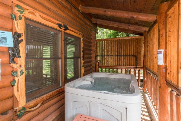 Hot tub with privacy fence at Granny's Creekside Cabin, a 6-bedroom cabin rental located in Pigeon Forge