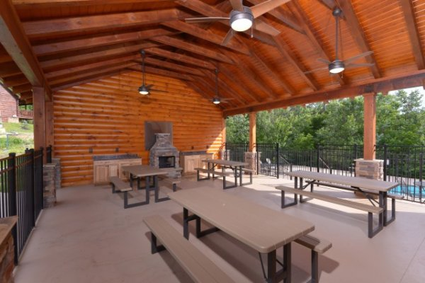 Smoky Mountain Ridge Resort picnic pavilion near the pool at Granny's Creekside Cabin, a 6-bedroom cabin rental located in Pigeon Forge