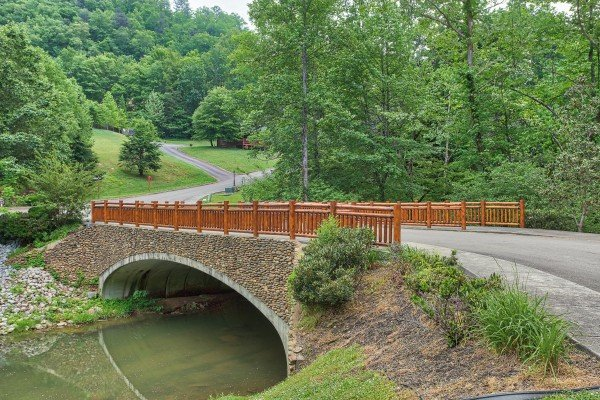 Bridge over the creek at Creekside Lodge, a 6-bedroom cabin rental located in Pigeon Forge