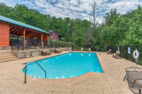 Pool and deck chairs at Creekside Lodge, a 6-bedroom cabin rental located in Pigeon Forge