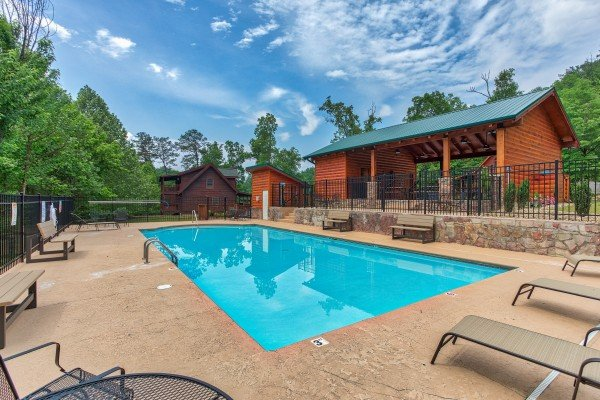 Pool and pavilion at Creekside Lodge, a 6-bedroom cabin rental located in Pigeon Forge