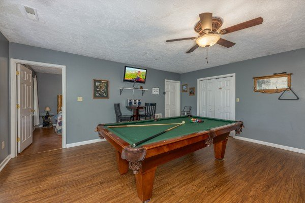 Pool table in a game room at Wildlife Retreat, a 3 bedroom cabin rental located in Pigeon Forge