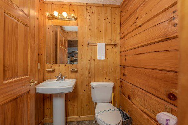 Half bath at Wildlife Retreat, a 3 bedroom cabin rental located in Pigeon Forge