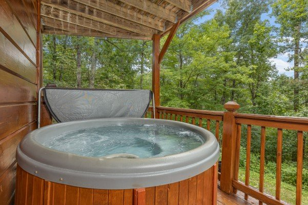 Hot tub on a deck at Wildlife Retreat, a 3 bedroom cabin rental located in Pigeon Forge