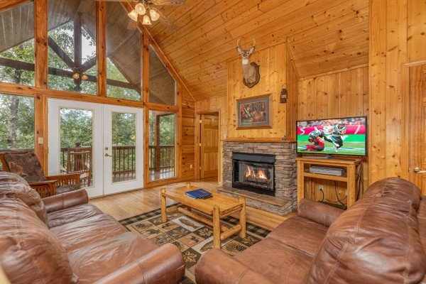 Living room with fireplace and TV at Wildlife Retreat, a 3 bedroom cabin rental located in Pigeon Forge