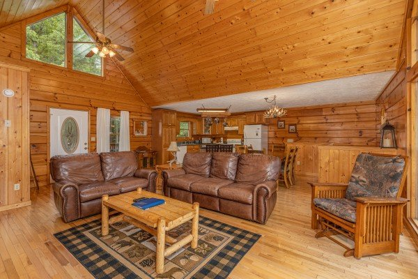 Living room with dining and kitchen attached at Wildlife Retreat, a 3 bedroom cabin rental located in Pigeon Forge