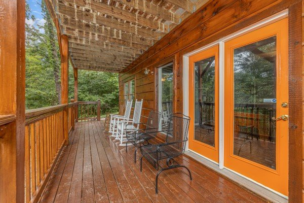 Seating on a deck at Wildlife Retreat, a 3 bedroom cabin rental located in Pigeon Forge