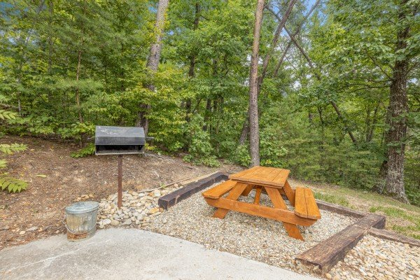 Charcoal grill and a picnic table at Wildlife Retreat, a 3 bedroom cabin rental located in Pigeon Forge