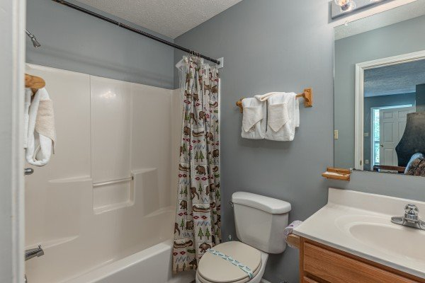 Bathroom with a tub and shower at Wildlife Retreat, a 3 bedroom cabin rental located in Pigeon Forge