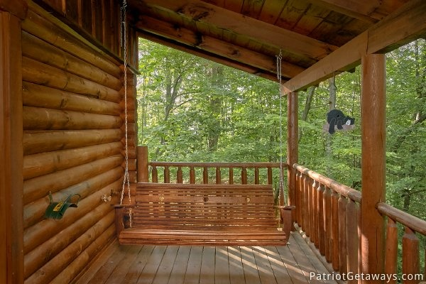 swing on the back deck of a gatlinburg cabin rental