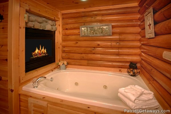 Jacuzzi tub by fireplace at A Bear's View, a 1 bedroom cabin rental located in Gatlinburg