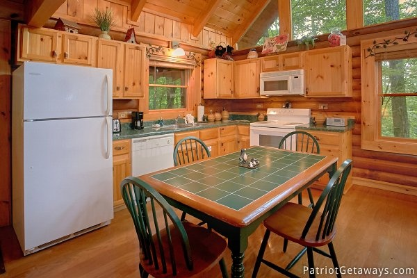 Kitchen and dining area at A Bear's View, a 1 bedroom cabin rental located in Gatlinburg