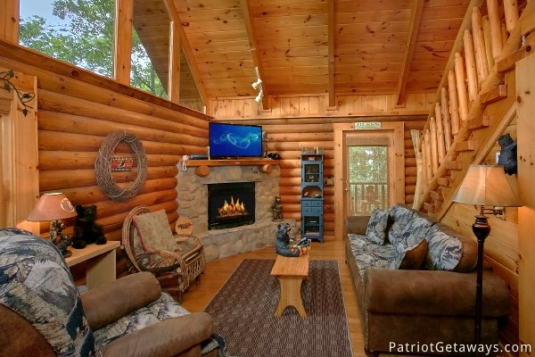 stone fireplace in the living room of this gatlinburg cabin