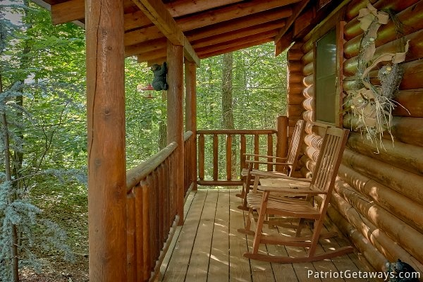 Rocking chairs on the front porch at A Bear's View, a 1 bedroom cabin rental located in Gatlinburg