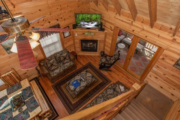 Looking down into the living room at My Smoky Mountain Hideaway, a 3 bedroom cabin rental located in Pigeon Forge