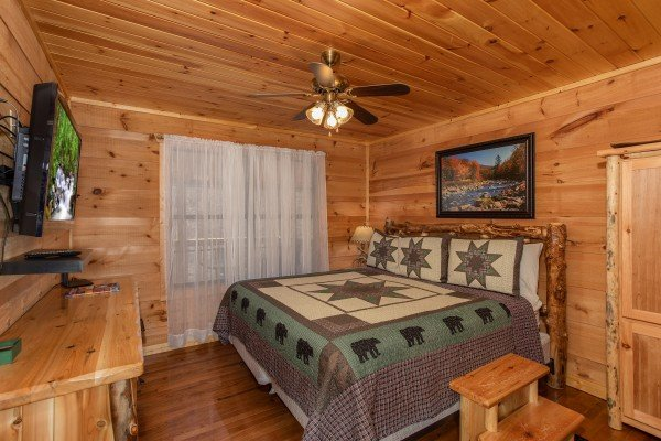 King bedroom with dresser and TV at My Smoky Mountain Hideaway, a 3 bedroom cabin rental located in Pigeon Forge