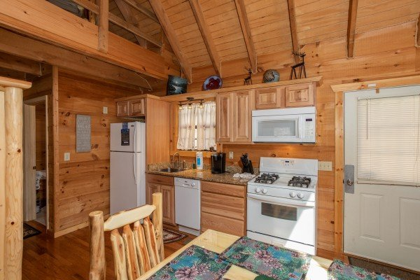 Kitchen with white appliances at My Smoky Mountain Hideaway, a 3 bedroom cabin rental located in Pigeon Forge