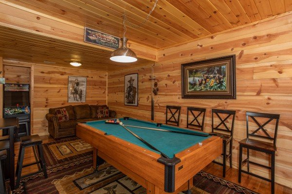 Pool table in the basement at My Smoky Mountain Hideaway, a 3 bedroom cabin rental located in Pigeon Forge