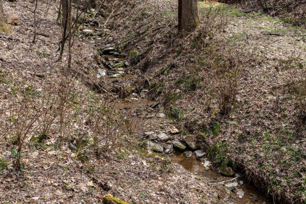 Stream on property at My Smoky Mountain Hideaway, a 3 bedroom cabin rental located in Pigeon Forge