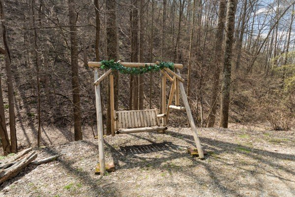 Swing in the yard at My Smoky Mountain Hideaway, a 3 bedroom cabin rental located in Pigeon Forge