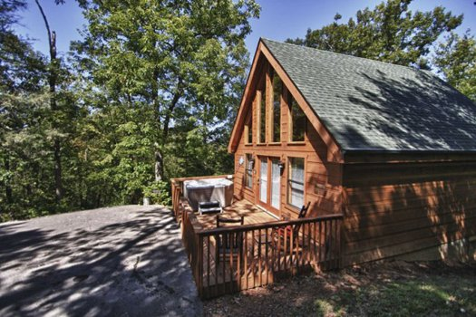 Exterior view looking toward the deck and the cabin at Gnarled Oak, a 2-bedroom cabin rental located in Gatlinburg