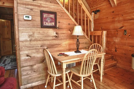 Dining table for three at Gnarled Oak, a 2-bedroom cabin rental located in Gatlinburg