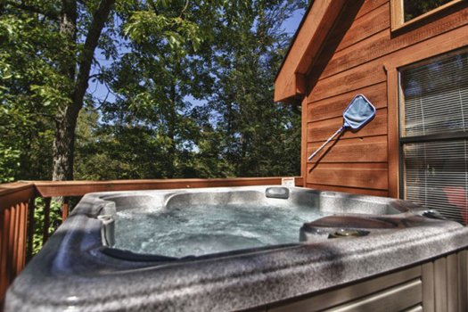 Hot tub on a deck at Gnarled Oak, a 2-bedroom cabin rental located in Gatlinburg