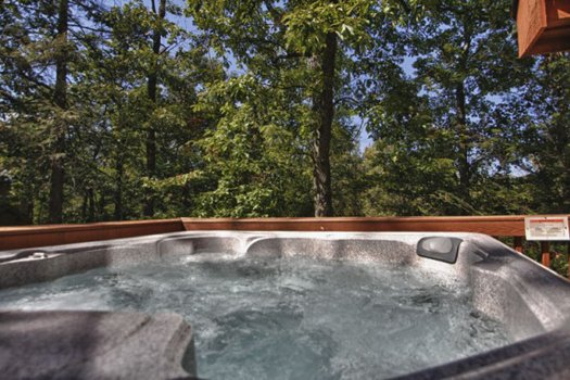 Hot tub with wooded views at Gnarled Oak, a 2-bedroom cabin rental located in Gatlinburg