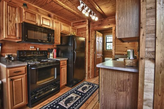 Kitchen with black appliances at Gnarled Oak, a 2-bedroom cabin rental located in Gatlinburg