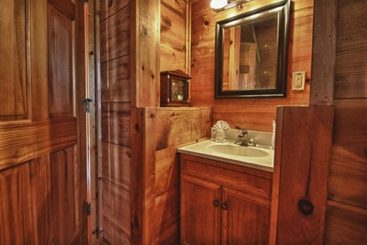 Vanity space in the queen bedroom at Gnarled Oak, a 2-bedroom cabin rental located in Gatlinburg