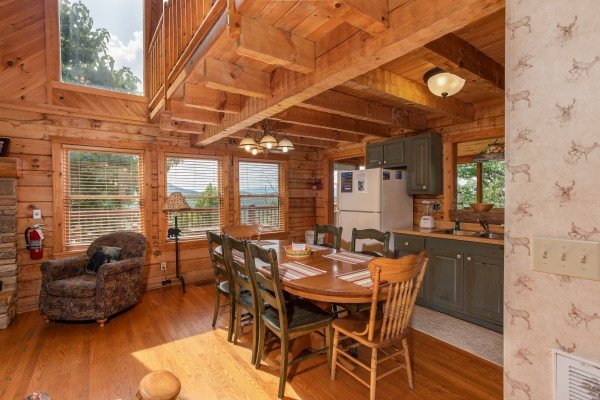 Dining table with seating for seven at Cabin in the Clouds, a 3-bedroom cabin rental located in Pigeon Forge