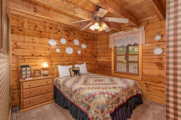 Bedroom with a dresser at Cabin in the Clouds, a 3-bedroom cabin rental located in Pigeon Forge
