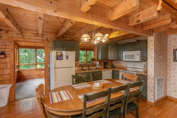 Eat-in kitchen with dining space for seven at Cabin in the Clouds, a 3-bedroom cabin rental located in Pigeon Forge