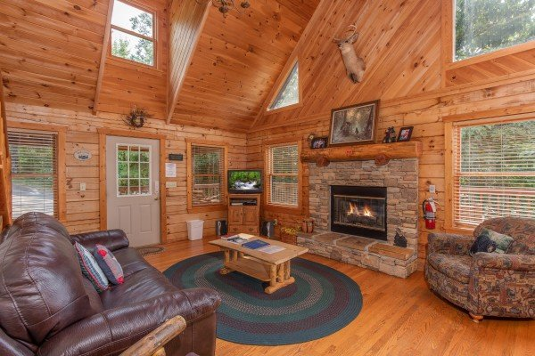 Fireplace and television in the living room at Cabin in the Clouds, a 3-bedroom cabin rental located in Pigeon Forge