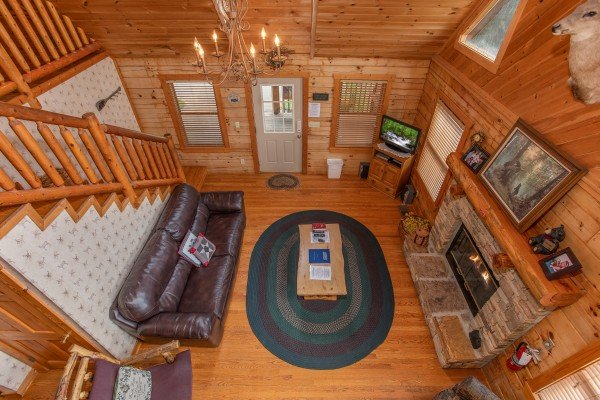 Looking down into the living room at Cabin in the Clouds, a 3-bedroom cabin rental located in Pigeon Forge