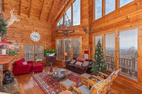 Living room with a Christmas tree at The Original American Dream, a 2 bedroom cabin rental located in Gatlinburg