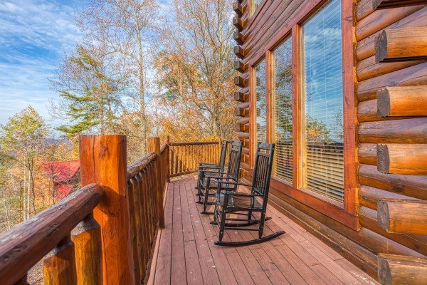 Rocking chairs on the deck at The Original American Dream, a 2 bedroom cabin rental located in Gatlinburg
