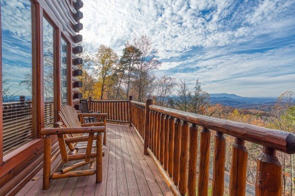 Deck with seating and mountain views at The Original American Dream, a 2 bedroom cabin rental located in Gatlinburg